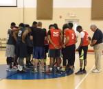 Prayer circle before game starts at Bethel Baptist Church, Spring league