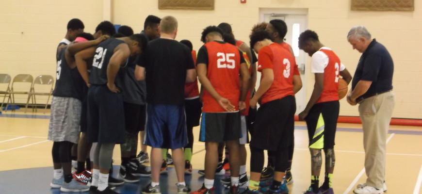 Prayer circle before game at Bethel Baptist Church