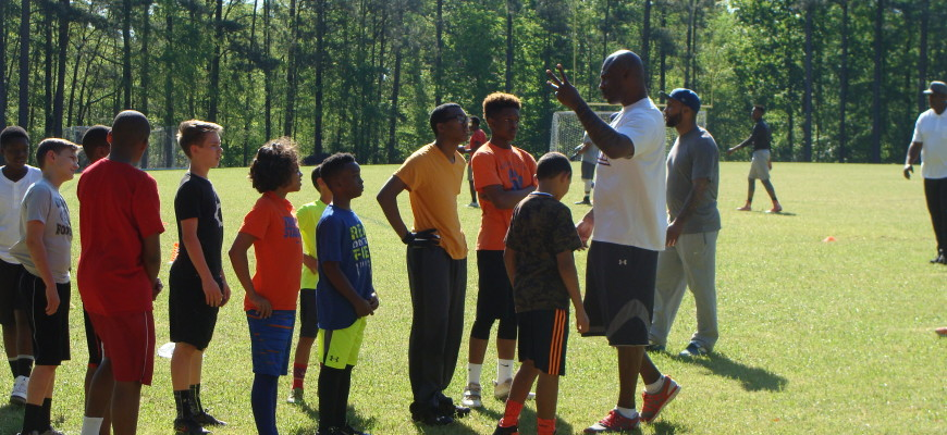 Brandon Jacobs with the kids at Football camp